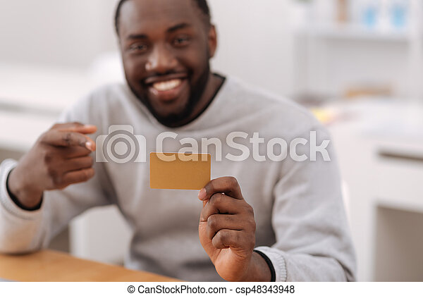 Credit card being held by a positive nice man - csp48343948