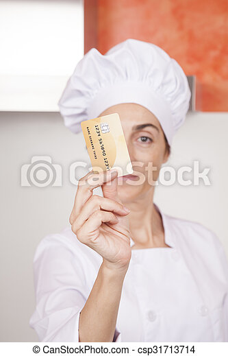 credit card in woman chef hand - csp31713714