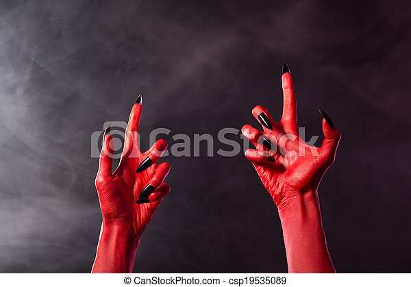 creepy red devil hands with black sharp nails creepy red devil