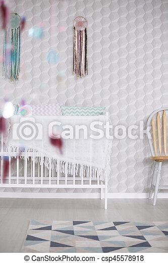 Crib against white wall - csp45578918
