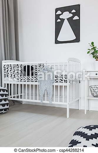Crib in baby room - csp44288214