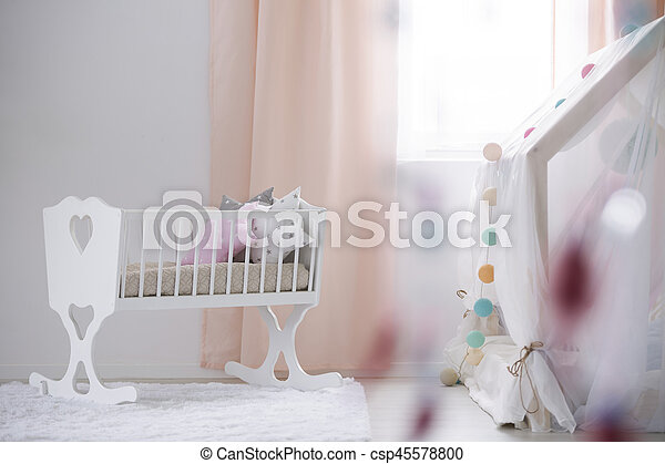 Crib in baby room - csp45578800