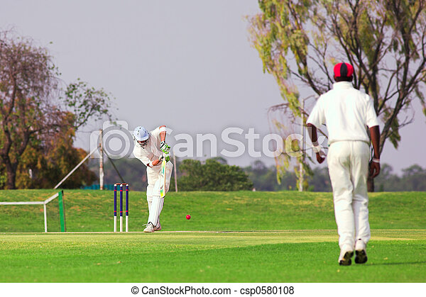 Cricket player hitting ball - csp0580108