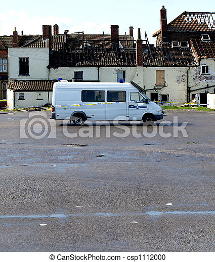 Crime Scene Fire Damaged House with police van outside - csp1112000