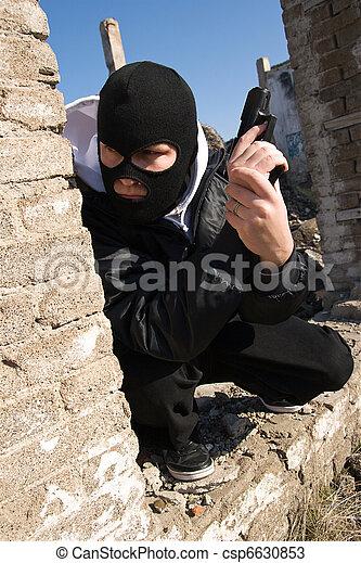 Criminal with a gun - csp6630853
