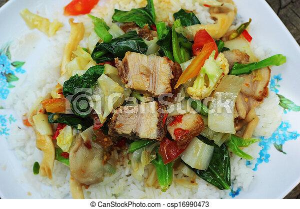 Crispy roasted pork stir fry with vegetables and rice