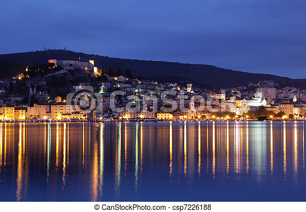 Croatian town Sibenik illuminated at dusk - csp7226188