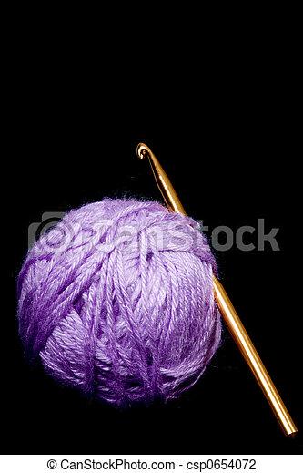 Crochet Hook And Yarn Crochet Hook And Ball Of Yarn Isolated On Black