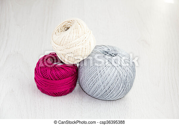 Crochet Hooks And Balls Of Yarn On Wooden Background With Copy Space