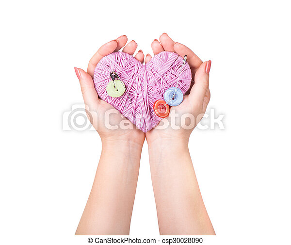 crocheted heart in hand isolated on white - csp30028090