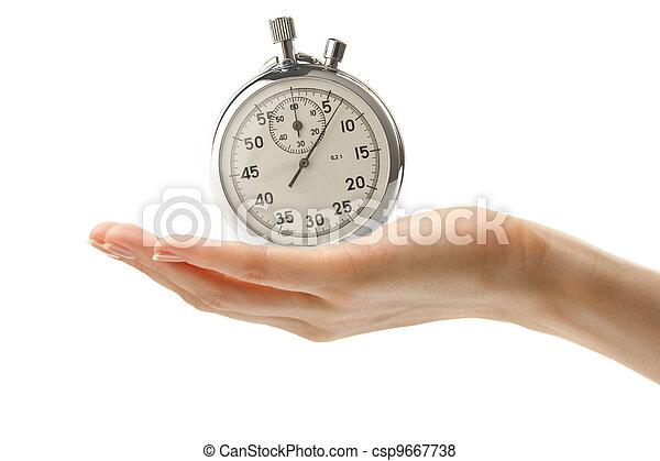 Mano femenina con un cronómetro - csp9667738