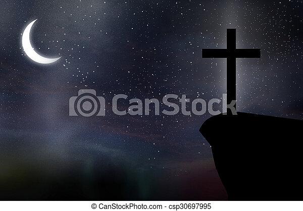 Cross against night sky - csp30697995