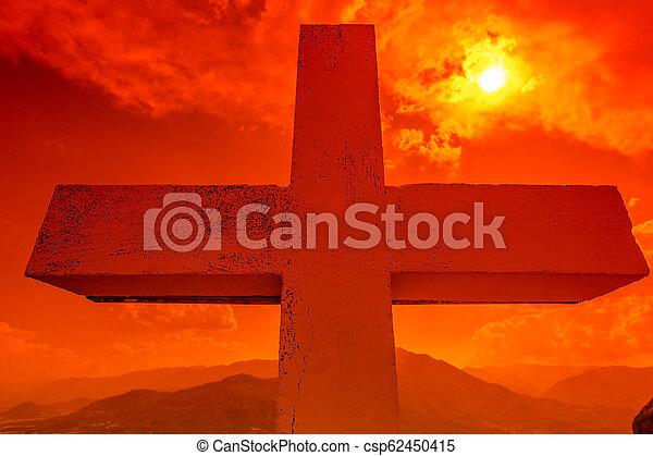 Cross at sunset - csp62450415