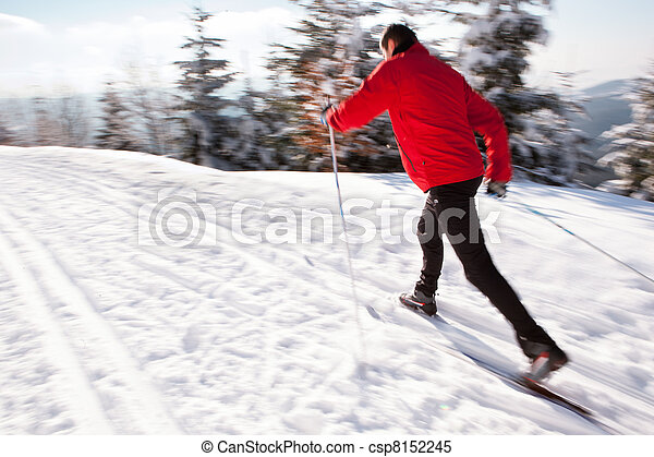 Cross-country skiing: young man cross-country skiing  - csp8152245