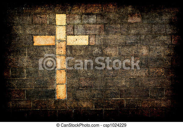cross of christ built into a brick wall - csp1024229