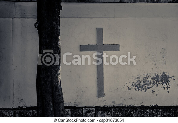 cross on the white wall - csp81873054
