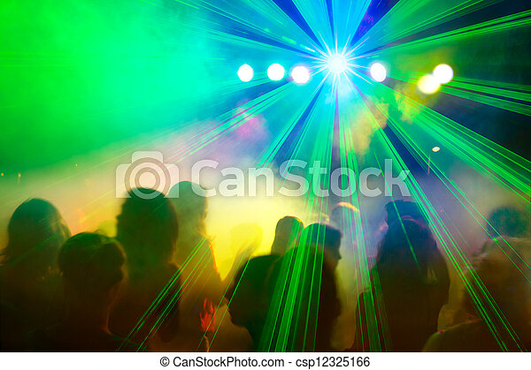 Crowd dancing under disco laser beam. - csp12325166