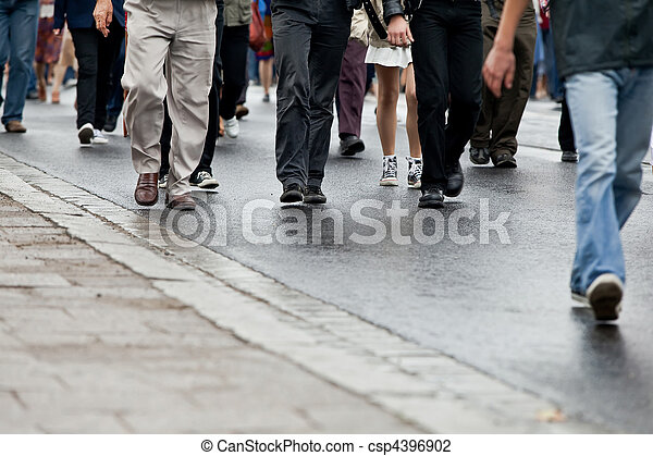 Crowd walking - group of people walking together (motion blur) - csp4396902