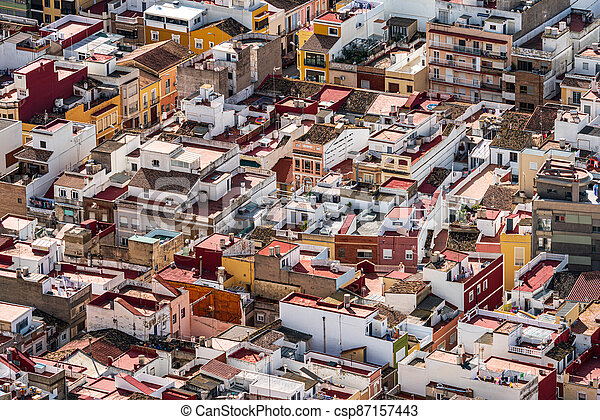 Crowded city roofs top view with many houses - csp87157443