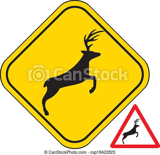 Un ciervo cruzando la señal de aviso de tráfico. - csp18422823