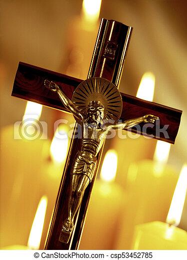 Crucifix and church candles - csp53452785