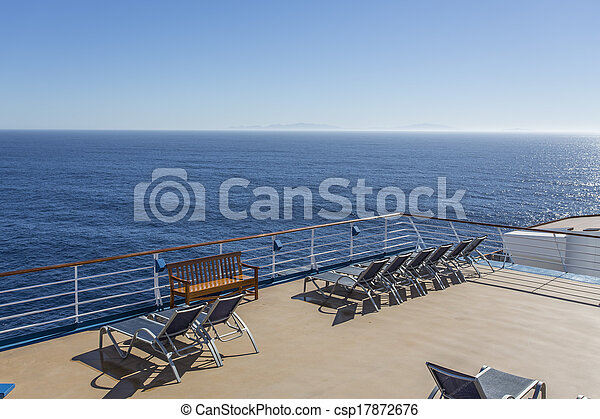 cruise ship deck lounge chairs on deck of luxury cruise ship