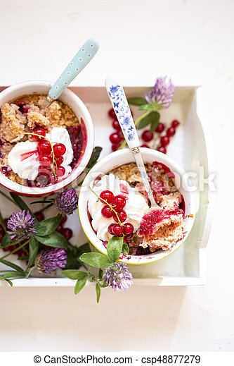 crumble with fresh berries and whipped cream - csp48877279