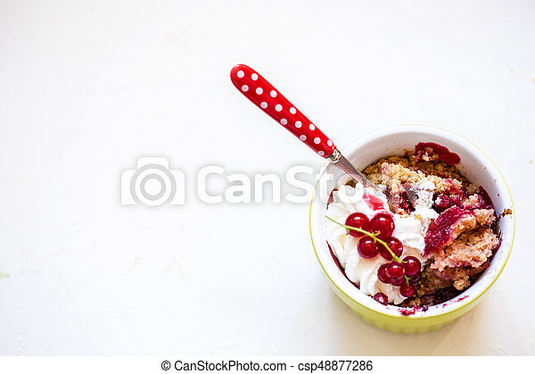 crumble with fresh berries and whipped cream - csp48877286
