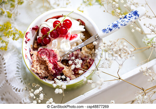 crumble with fresh berries and whipped cream - csp48877269