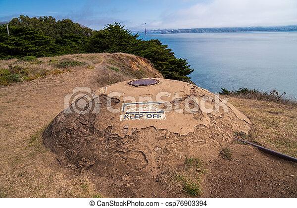 Crumbling World War II era bunk overlooking Golden Gate Bridge - csp76903394