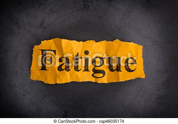 Crumpled piece of paper with the word Fatigue - csp46035174