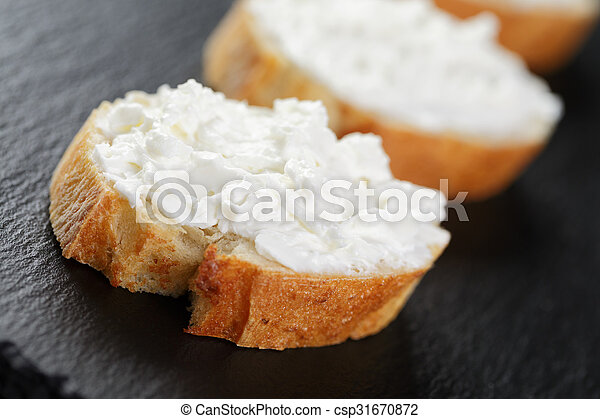 crunchy baguette slices with cream cheese - csp31670872