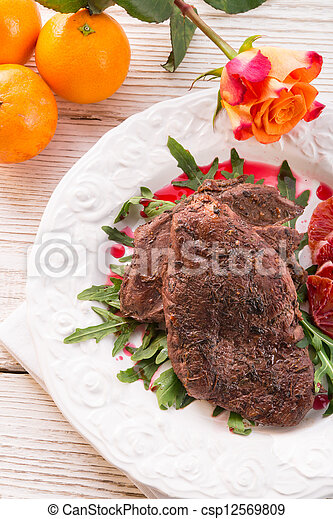 crunchy duck's breast with orange and rucola - csp12569809