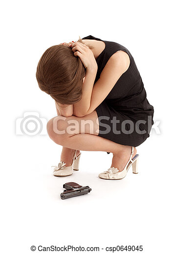 crying girl with a gun - csp0649045