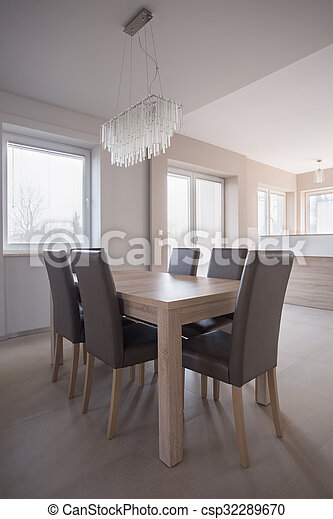 Delightful Crystal Chandelier In Dining Room   Csp32289670