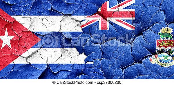 Cuba flag with Cayman islands flag on a grunge cracked wall - csp37800280