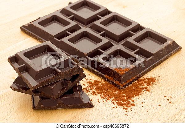 Cubes of dark chocolate - csp46695872