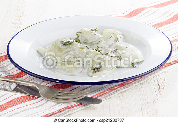cucumber salad with sour cream and dill - csp21280737