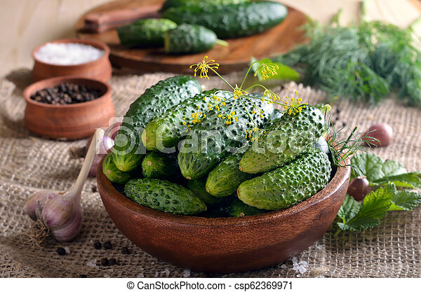Cucumbers in wooden bowl - csp62369971