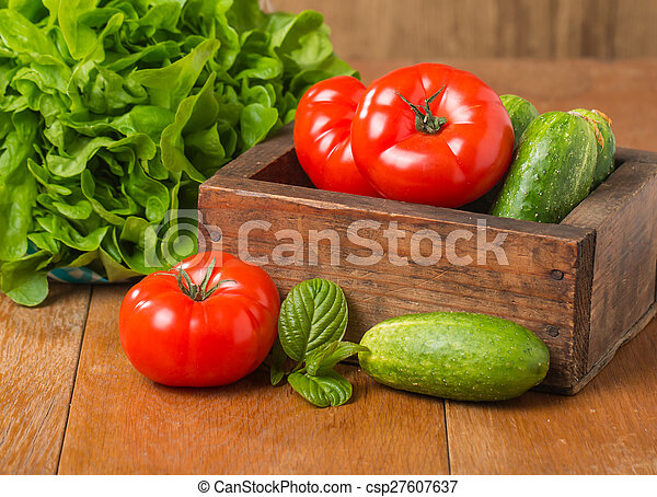 Cucumbers, Tomatoes and Butterhead Lettuce in Wooden Box - csp27607637