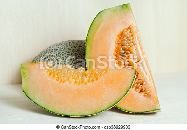 Cucumis Melo Or Melon With Half And Seeds On Wooden Plate Other