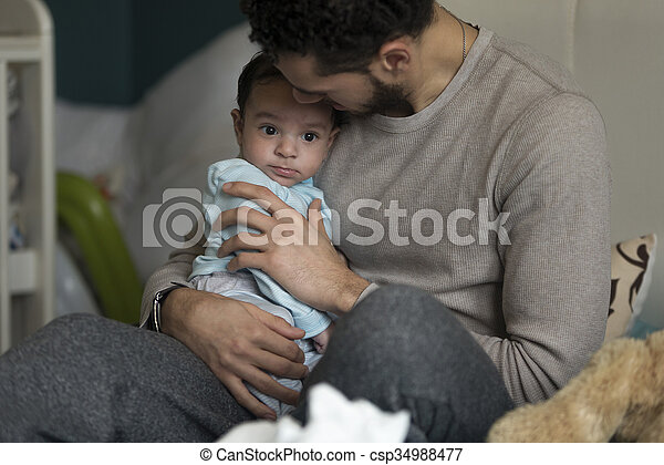 Cuddles with daddy - csp34988477