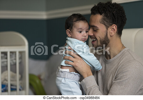 Cuddles with daddy - csp34988484