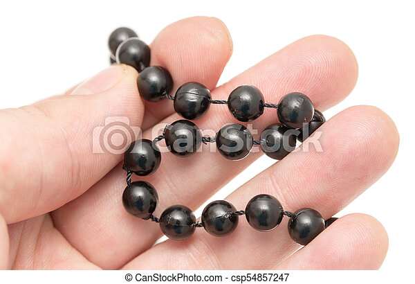 Cuentas negras en mano sobre un fondo blanco - csp54857247