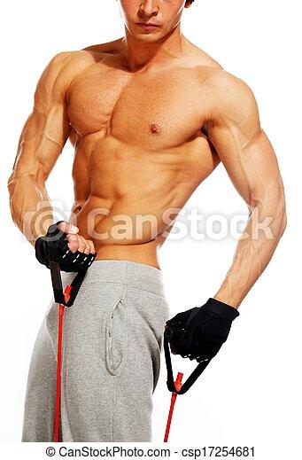 Un hombre apuesto con cuerpo musculoso haciendo ejercicio - csp17254681