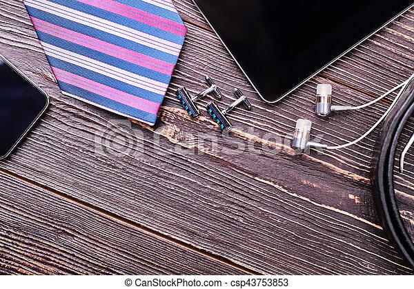 Cufflinks and striped necktie. - csp43753853