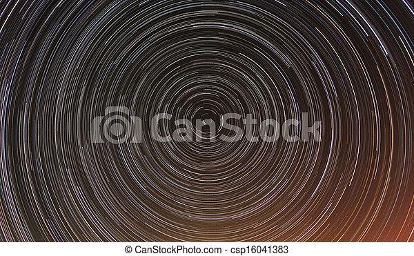 Cumulative time lapse of star trails in night sky. - csp16041383