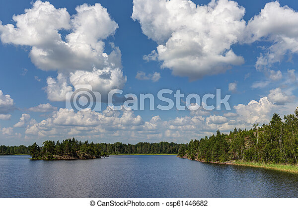 cumulus clouds over the summer lake - csp61446682