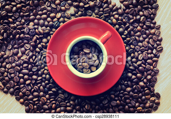 Cup full of coffee beans - csp28938111
