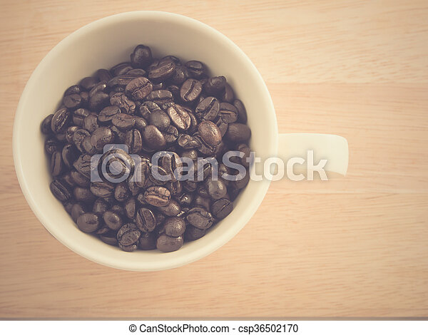 Cup full of coffee beans - csp36502170